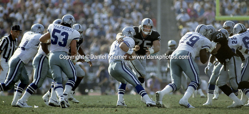 Los Angeles Raiders defensive end Howie Long pressures Dallas Cowboys quarterback Troy Aikman on October 25, 1992. SThe Cowboys beat the Raiders 28-13 at the Los Angeles Memorial Coliseum.