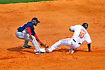 6 March 2009: Washington Nationals' infielder Cristian Guzman attempts a tag at second on a base-stealing Adam Jones during the second inning of a Spring Training game against the Baltimore Orioles at Fort Lauderdale Stadium in Fort Lauderdale, Florida. The Orioles defeated the Nationals 6-2 in the Grapefruit League matchup. Mandatory Photo Credit: Ed Wolfstein Photo