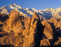 Granite formations of the Alabama Hills and distant Lone Pine Peak and Mt. Whitney, Eastern Sierra Nevada, California, USA.