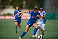 Seattle, WA - Sunday, May 21, 2017: Katlyn Johnson and Ali Krieger during a regular season National Women's Soccer League (NWSL) match between the Seattle Reign FC and the Orlando Pride at Memorial Stadium.