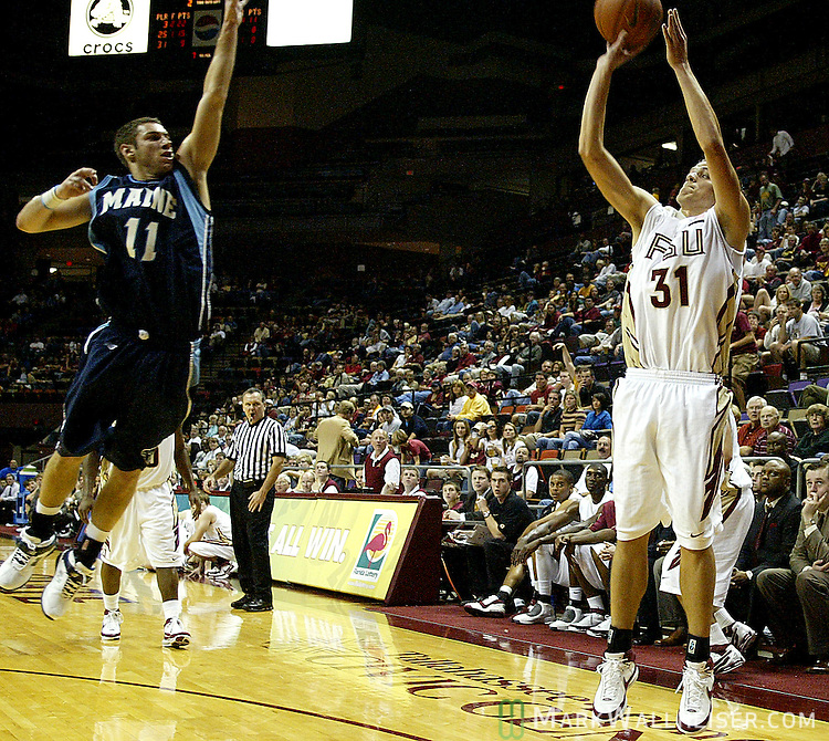 FSU's Brian Hoff (31) sinks a three pointer, one of five on the night as the Florida State Seminoles defeated the Maine Black Bears 95-55 with a school record 20 three point shots at the Tallahassee-Leon Civic Center December 8, 2007. (Mark Wallheiser/TallahasseeStock.com)