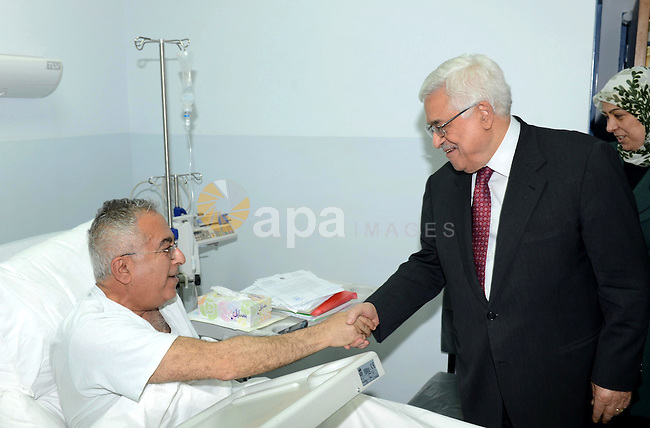 Palestinian President Mahmoud Abbas, visits Palestinian Prime Minister Salam Fayyad in a Ramallah, West Bank hospital, 02 April 2013. Fayyad was admitted to hospital last night with stomach pains from an abdominal infection and is reported in stable condition. Photo by Thaer Ganaim
