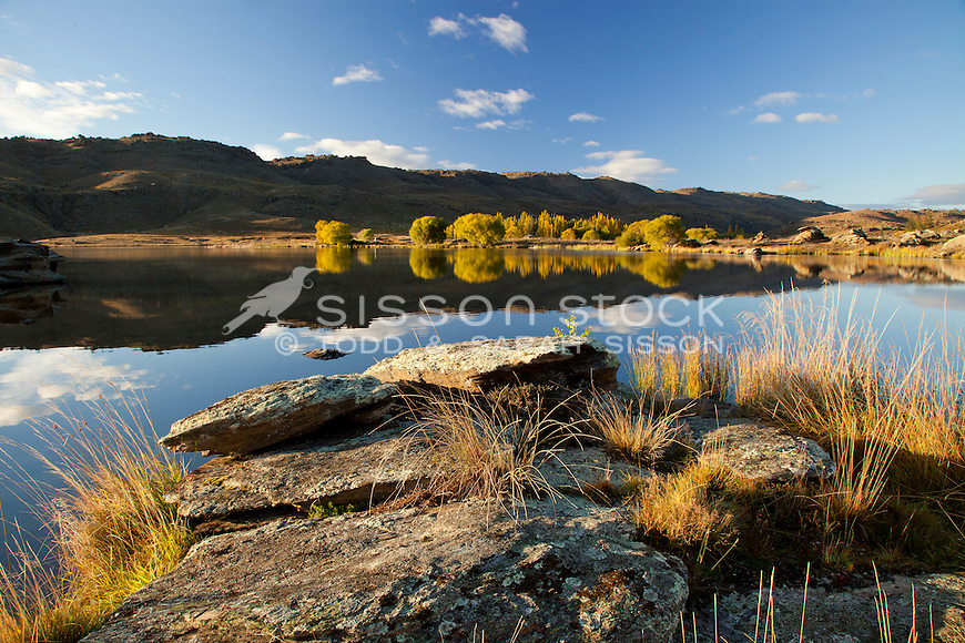 Early morning light and reflections at Butchers Dam near Alexandra, Central Otago, South Island, New Zealand- stock photo, canvas, fine art print