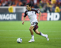 Pablo Mastroeni (25) of the Colorado Rapids carries the ball upefield during the game at RFK Stadium in Washington, DC.  D.C. United tied the Colorado Rapids, 1-1.