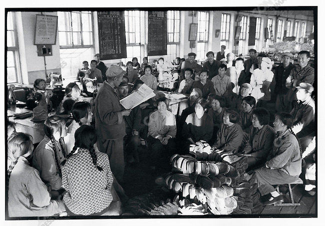 In the mid-1970s, China set about redressing the economic ruin wrought by the decade of social unrest. Here, workers in the Harbin Shoe Factory discuss the development of new styles of shoes to meet market needs; Harbin, Heilongjiang Province. November 19, 1974