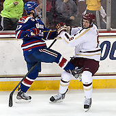 Zack Kamrass (UML - 27), Travis Jeke (BC - 8) - The University of Massachusetts Lowell River Hawks defeated the Boston College Eagles 4-2 (EN) on Tuesday, February 26, 2013, at Kelley Rink in Conte Forum in Chestnut Hill, Massachusetts.