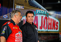 Apr 22, 2017; Baytown, TX, USA; Papa Johns Pizza founder John Schnatter (right) talks with Joe Barlam, crew chief for NHRA top fuel driver Leah Pritchett (not pictured) during qualifying for the Springnationals at Royal Purple Raceway. Mandatory Credit: Mark J. Rebilas-USA TODAY Sports
