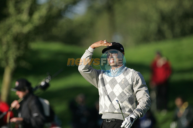 Straffin Co Kildare Ireland. K Club Ruder Cup...American Ryder Cup team member Tiger Woods looks a bit under the weather after hiting his second shot on the forth fairway during the opening fourball session of the first day of the 2006 Ryder Cup, at the K Club in Straffan, Co Kildare, in the Republic of Ireland, 22 September 2006..Photo: Fran Caffrey/ Newsfile.<br />