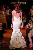 Model walks the runway in an Enthrall wedding dress - hand painted silk satin mermaid gown with bustle back, by Sarah Jassir, for the Sarah Jassir Couture Bridal Fall 2012 Opulence collection.