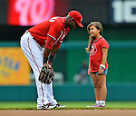 22 July 2012: Washington Nationals outfielder Roger Bernadina has a chat with a young fan prior to a game against the Atlanta Braves at Nationals Park in Washington, DC. The Nationals defeated the Braves 9-2 to split their 4-game weekend series. Mandatory Credit: Ed Wolfstein Photo