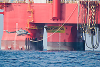 Greenpeace climbers scale the deepwater oil rig ?Centenario?, located 100 kilometers away from the coast of the State of Veracruz, in Mexico and deploy a banner that reads ?Go Beyond Oil?. Greenpeace calls for an end to deepwater drilling and sends a strong message to all the nations that will soon meet in Cancun for the COP16 UN conference that it is time to end our addiction to fossil fuels. (Photo: Greenpeace / Prometeo Lucero)