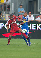 03 July 2013: Montreal Impact defender Matteo Ferrari #13 and Toronto FC midfielder Reggie Lambe #19 in action during an MLS game between the Montreal Impact and Toronto FC at BMO Field in Toronto, Ontario Canada.<br /> The game ended in a 3-3 draw.