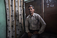 "Nepal - Kathmandu - Ramesh Pathak, 33-year-old, sitting in a guesthouse close to the airport, comes from the village of Prithvinagar, in the Eastern district of Jhapa. In a few days time he will leave for Qatar, where he will work as a furniture sprayer together with his uncle. Although he has been told by an agent he will be paid around 330 USD per month, Pathak is unable to read the Arabic-written-contract he had been given. His goal is to stay in Qatar for two years and earn enough money to pay for the education of his two kids, aged 4 and 1. ""I will have to work overtime in order to raise that sum"" he says."