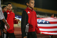 The United States flag is brought on the field by school children before  the match against South Korea during the FIFA Under 20 World Cup Group C match between the United States and South Korea at the Mubarak Stadium on October 02, 2009 in Suez, Egypt.
