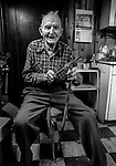 """December 1971:  Modesto, California—Dad Walkling—Dad work on his new business project, making Canes from dried bull penises. I first met Orlando """"Dad"""" Walkling at his house in the airport district of Modesto just before his 104th birthday.  Walkling was born in Indian Territory January 2, 1868, near a town now called McAlester, Oklahoma.  His mother was Shawnee and his father, whom he didn't remember, was an Englishman named Orlando.  He later used the name Walkling instead of his Indian name of Skipocase.  On September 16, 1893, Skipocase O. Walkling, then 25 years old, was among thousands of settlers who rode into the Cherokee Strip Land Run of Oklahoma to make a free land claim.  Walkling told of how he rode into the 226-mile long """"Strip"""" to claim 160 acres.  """"There were thousands of men who waited at the line until noon that day.  The army gun was fired and chaos broke out. Every man carried a gun. There was no law, no sheriff, nothing.  People had to fight for their claim even though they were first.""""  Walkling made a claim, but later gave it up when he had a chance to farm a piece of land in Noble County, Oklahoma.  He cleared the land with six yoke of oxen and planted peach orchards.  He and his first wife ran a combination grocery store and hotel there.  He had nearly 1,000 trees and began a cannery to process the crops.  """"One day when the train came in a woman dressed like a Salvation Army woman handed me a bundle as I stood on the ramp, then she jumped back into the train.  I opened it and there was a pair of twins, a boy and a girl,"""" Walkling said.  He and his wife did not have children, so they adopted the twins legally and raised them.  He said they raised six others but did not adopt them.  He came to Modesto in 1944 at 76 years of age and went to work for a meat firm before he opened a poultry store.  After that store closed, he made bullwhips and wove rope for truckers at his home.  In 1968, Dad Walking, then 100 years old, visited Oklahoma"""
