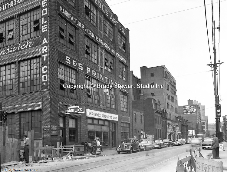 Pittsburgh PA:  View of Forbes Avenues and Stevenson Street in the uptown section of Pittsburgh near Duquesne University - 1950.  Assignment was for a developer trying to get some of the buildings condemned so he could get them at a good price for future development.