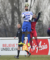 Armand Traore of QPR wins a header against Alex of Chicago Fire