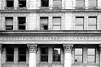 High contrast black and white image of the facade of the classical style Credit Foncier building in downtown Vancouver, BC, Canada