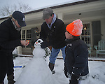 Ford Dye, Sonya Dye, and Jack Dye, 5, build a snowman in Oxford, Miss., on Monday, January 10, 2011.