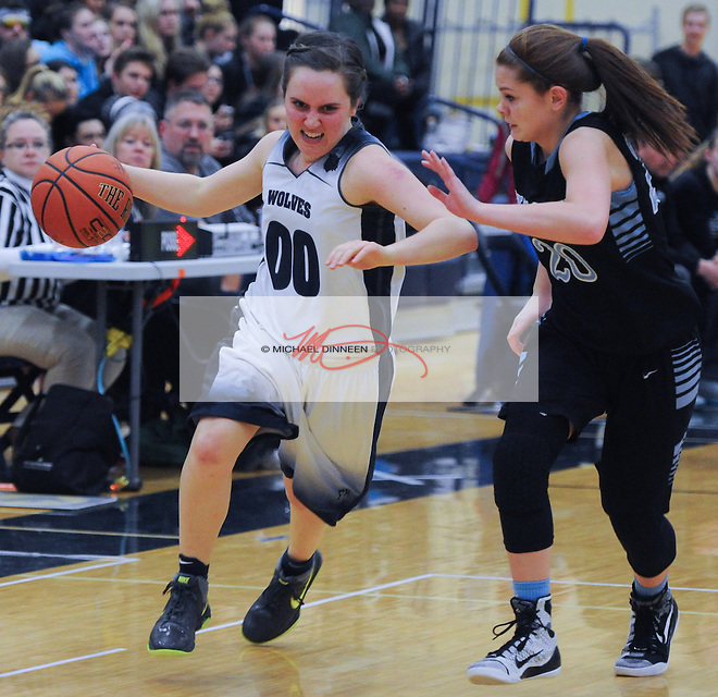Eagle River's Tessa Hagy (00) drives past Chugiak's Taylor Williams at Eagle River High School Tuesday January 19, 2016.  Photo for the Star by Michael Dinneen.