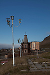 Russian Orthodox Pomor style church in Barentsburg, a Russian coal mining town in the Norwegian Archipelego of Svalbard. Once home to about 2000 miners and their families, less than 500 people now live here. The church was built as a memorial to the 141 miners and their families that died in a plane crash in 1996, and the year afterward when 23 miners were killed in a mining accident. The Cyrillic text reads &quot;peace on earth&quot;, on the mountain behind.
