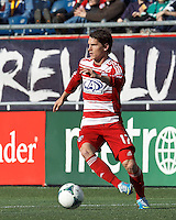 FC Dallas defender Zach Loyd (17) controls the ball and looks to pass..  In a Major League Soccer (MLS) match, FC Dallas (red) defeated the New England Revolution (blue), 1-0, at Gillette Stadium on March 30, 2013.