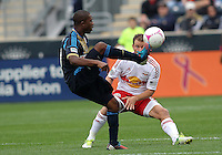 CHESTER, PA - OCTOBER 27, 2012:  Michael Lahoud (13) of the Philadelphia Union kicks the ball over  Teemu Tainio (6) of the New York Red Bulls during an MLS match at PPL Park in Chester, PA. on October 27. Red Bulls won 3-0.