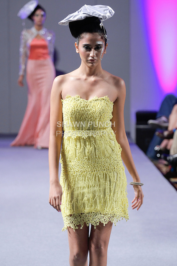 Model walks runway in an outfit from the Sushma Patel Spring 2013 collection, during Couture Fashion Week in New York September 2012.