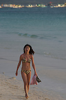 Sexy Chinese girl walking on the beach on Boracay Island, Philippines