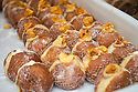 London, UK. 15.11.2014. Doughnuts with a garnish of honeycomb toffee on a stall at Borough Market. Photograph © Jane Hobson.