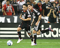 Jaime Moreno #99 and Santino Quaranta #25 of D.C. United move into the attack during an MLS match against the New England Revolution on April 3 2010, at RFK Stadium in Washington D.C.