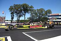 Jun 12, 2016; Englishtown, NJ, USA; NHRA top fuel driver J.R. Todd (near) races alongside Steve Torrence during the Summernationals at Old Bridge Township Raceway Park. Mandatory Credit: Mark J. Rebilas-USA TODAY Sports