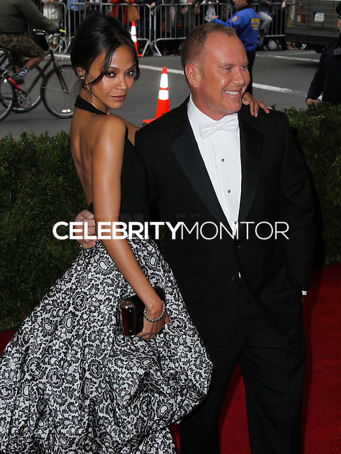 "NEW YORK CITY, NY, USA - MAY 05: Zoe Saldana, Michael Kors at the ""Charles James: Beyond Fashion"" Costume Institute Gala held at the Metropolitan Museum of Art on May 5, 2014 in New York City, New York, United States. (Photo by Xavier Collin/Celebrity Monitor)"