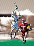23 March 2008: University of Vermont Catamounts' Liam Teer, a Freshman from Vancouver, British Columbia, jumps high to take possession against the Bellarmine University Knights at Moulton Winder Field, in Burlington, Vermont. The Catamounts defeated the visiting Knights 9-7 at the Vermont home opener...Mandatory Photo Credit: Ed Wolfstein Photo