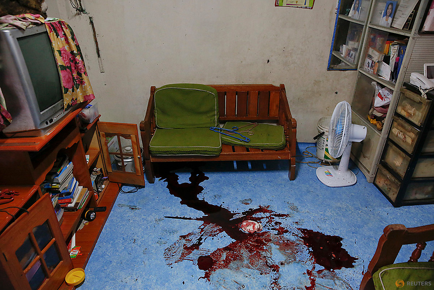 """Blood remains on the floor of a room where pedicab driver Norberto Maderal was killed by police who said he had pulled a gun and """"tried to open fire"""" during a drug sting operation in Manila, Philippines October 19, 2016. REUTERS/Damir Sagolj"""
