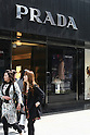 Apr 19, 2010 - Tokyo, Japan - Pedestrians pass in front of a Prada store in the Ginza district of Tokyo, Japan, on April 19, 2010. Rina Bovrisse, a former senior Retail manager at PRADA Japan, is suing the Italian fashion designer after she was placed on involuntary leave last November and she was asked to 'eliminate' around 15 managerial staff who was categorized as 'old, fat, ugly, disgusting or not having the Prada look'.
