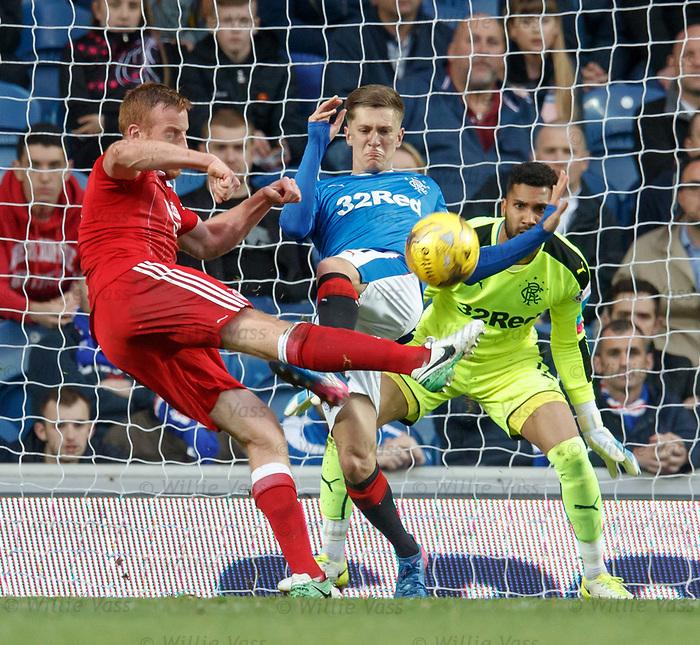 Wes Foderingham watches as Myles Beerman puts off Adam Rooney in front of goal