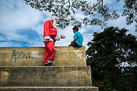Man dresses up as Santa Claus for visiting poor districts and distributing gifts to children at Christmas. Nova Friburgo city, Rio de Janeiro city, Brazil.