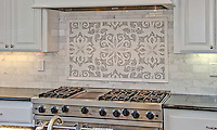 This custom Arabella mosaic backsplash is shown in polished Carrara and Thassos and is part of the Silk Road Collection by Sara Baldwin for New Ravenna.<br />