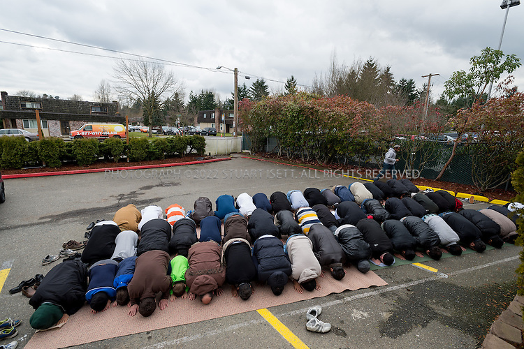 "2/8/2013--Bellevue, WA, USA..Friday midday prayers at the the ""Bellevue mosque"", officially known as the Islamic Center of Eastside, spill out into the parking lot and garden as the community has grown so much in recent years...©2013 Stuart Isett. All rights reserved."