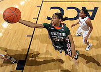Jan. 6, 2011; Charlottesville, VA, USA; Miami Hurricanes forward Morgan Stroman (32) grabs the rebound in front of Virginia Cavaliers guard Whitny Edwards (2) during the game at the John Paul Jones Arena. Miami won 82-73. Mandatory Credit: Andrew Shurtleff