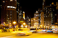 Chicago Wacker Drive at night at North Dearborn Street with motion blurred cars.