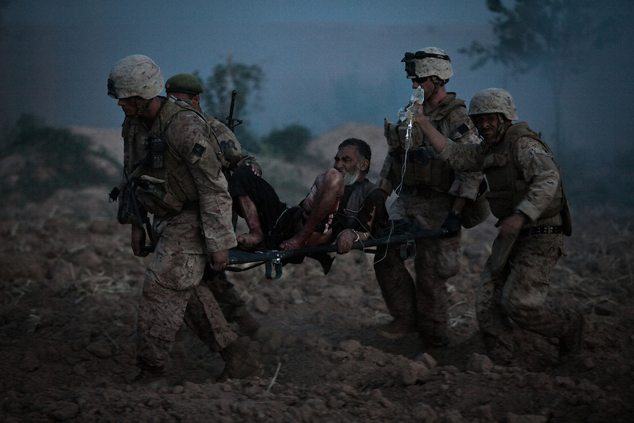 """Scenes from the medical evacuations of wounded Americans, Canadians, and Afghan civilians and soldiers being flown by Charlie Co. 6th Battalion 101st Aviation Regiment of the 101st Airborne Division. Charlie Co. - which flies under the call-sign """"Shadow Dustoff"""" - flies into rush the wounded to medical care out of bases scattered across Oruzgan, Kandahar, and Helmand Provinces in the Afghan south. These images were taken of missions flown out of Camp Dwyer in Helmand Province."""