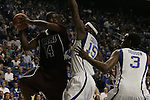 Freshman forward DeMarcus Cousins and sophomore guard Darnell Dodson block Campbellsville's Nester Colmenares during the first period of UK's first exhibition game of the season at Rupp Arena on Monday, Nov. 2, 2009.