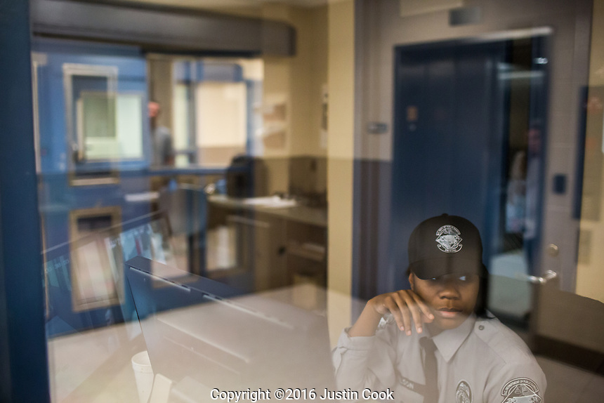 A guard mans a control room at  Central Prison's hospital in Raleigh, NC on Thursday, November 17, 2016. (Justin Cook)