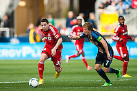 Hogan Ephraim (31) of Toronto FC is marked by Brian Carroll (7) of the Philadelphia Union. Toronto FC and the Philadelphia Union played to a 1-1 tie during a Major League Soccer (MLS) match at PPL Park in Chester, PA, on April13, 2013.