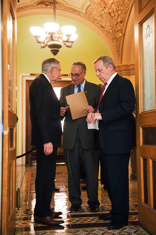 UNITED STATES - OCTOBER 05:  From left, Senate Majority Leader Harry Reid, D-Nev., Sen. Charles Schumer, D-N.Y., and Senate Majority Whip Richard Durbin, D-Ill., prepare for a news conference in the Capitol to call on the Senate to pass the President Obama's $447 billion bill, The American Jobs Act, and to enact a new tax on millionaires to help pay for it.  (Photo By Tom Williams/Roll Call)