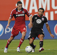 D.C. United forward Dwayne De Rosario (7) goes against Chicago FIre defender Austin Berry (22)  D.C. United defeated The Chicago Fire 4-2 at RFK Stadium, Wednesday August 22, 2012.