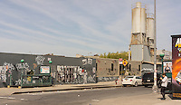 Industrial street scene in the Bushwick neighborhood of Brooklyn in New York on Saturday, April 19, 2014. The neighborhood is undergoing gentrification changing from a rough and tumble mix of Hispanic and industrial to a haven for hipsters, forcing many of the long-time residents out because of rising rents.. (© Richard B. Levine)