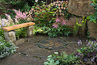Garden bench, big stone pavers, decorated paver with perennials, wall, ferns 37292